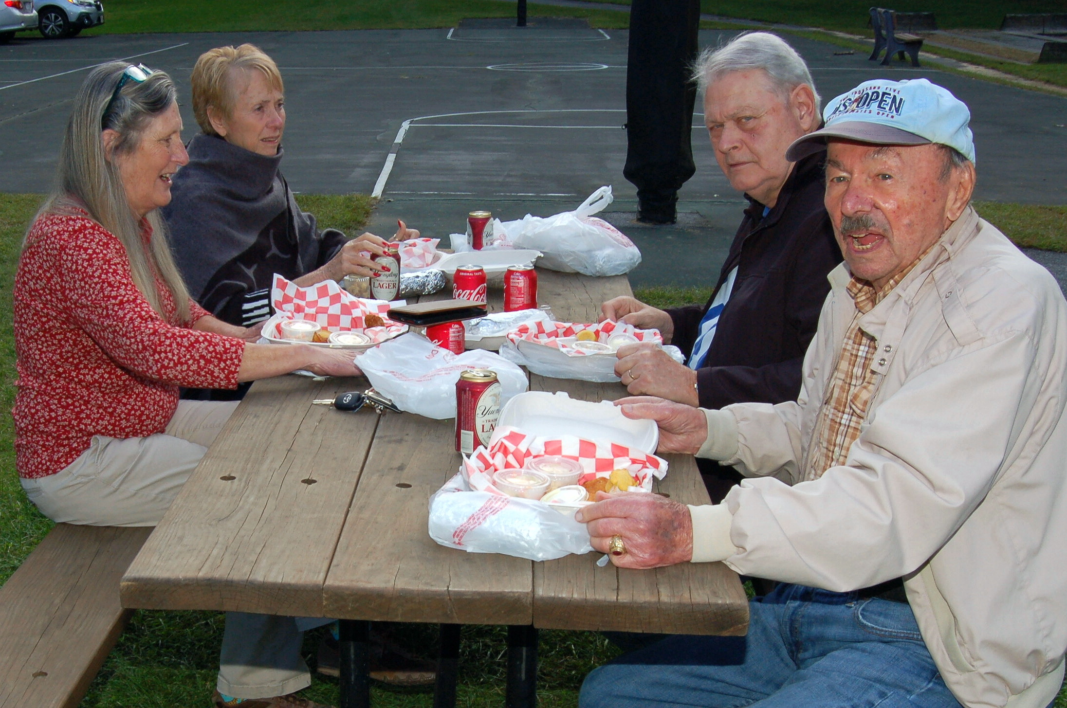 Some of the diners enjoyed their dinners at picnic tables in the park